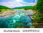 mountain valley forest river... | Shutterstock . vector #1043993512