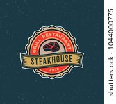vintage steak house logo. retro ... | Shutterstock .eps vector #1044000775