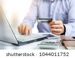 businessman do online shopping... | Shutterstock . vector #1044011752