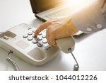 businessman dial digital... | Shutterstock . vector #1044012226