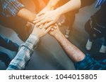 teamwork unity arms... | Shutterstock . vector #1044015805