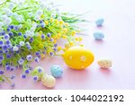 spring flowers with easter eggs ... | Shutterstock . vector #1044022192