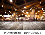 Small photo of closeup top wood table with Blur Background, for your photo montage or product display, Space for placing items on the table.