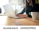 cropped shot view of a women's... | Shutterstock . vector #1044029002