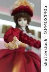 vintage girl doll in beauty red ... | Shutterstock . vector #1044031405