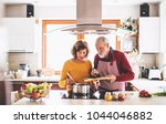 senior couple preparing food in ...   Shutterstock . vector #1044046882