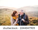 senior couple on a walk in an... | Shutterstock . vector #1044047905