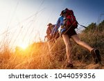 lady hikers walking in the... | Shutterstock . vector #1044059356