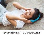 asian women are listening to...   Shutterstock . vector #1044060265