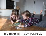 children playing puzzles at home | Shutterstock . vector #1044060622