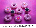 delicious pink donuts on pink... | Shutterstock . vector #1044082915