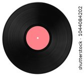 black vinyl record with pink... | Shutterstock . vector #1044084202