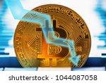 bitcoin fall down. golden... | Shutterstock . vector #1044087058