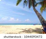tranquil beach scene. exotic... | Shutterstock . vector #1044093472