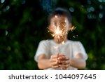 beautiful little candle...   Shutterstock . vector #1044097645
