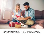 smiling young couple in love... | Shutterstock . vector #1044098902