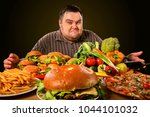 diet fat man who makes choice... | Shutterstock . vector #1044101032