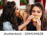 portrait of delighted teen... | Shutterstock . vector #1044144628