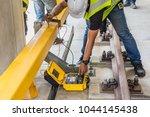 engineer using electrical... | Shutterstock . vector #1044145438