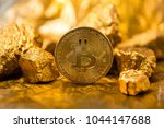 gold coin bitcoin and a mound... | Shutterstock . vector #1044147688