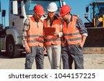 truck drivers and dispatcher in ... | Shutterstock . vector #1044157225