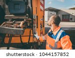 garbage removal worker emptying ... | Shutterstock . vector #1044157852