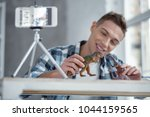 being inspired. nice cheerful... | Shutterstock . vector #1044159565