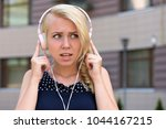 woman with confused face... | Shutterstock . vector #1044167215
