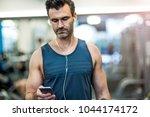 man exercising in gym | Shutterstock . vector #1044174172