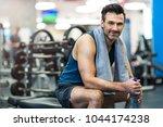 man exercising in gym | Shutterstock . vector #1044174238