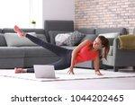 beautiful young woman doing... | Shutterstock . vector #1044202465