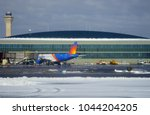 Small photo of NEWARK, NJ -8 MAR 2018- View of an airplane from low-cost airline Allegiant Air (G4) after a winter snow storm at Newark Liberty International Airport (EWR) near New York City.