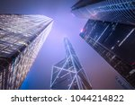 looking up to skyscrapers and... | Shutterstock . vector #1044214822