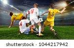 stadium in the evening in full... | Shutterstock . vector #1044217942