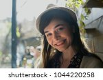 portrait of a young woman with... | Shutterstock . vector #1044220258