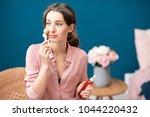 young woman applying facial... | Shutterstock . vector #1044220432