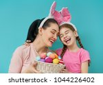 happy holiday  mother and her... | Shutterstock . vector #1044226402