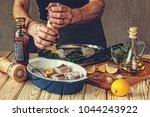 chef prepares the fish.... | Shutterstock . vector #1044243922