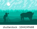 photographer photographs bison... | Shutterstock .eps vector #1044249688