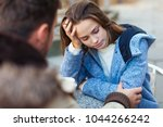 young couple fighting in coffee ... | Shutterstock . vector #1044266242