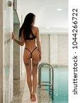 slim tattooed brunette in the... | Shutterstock . vector #1044266722