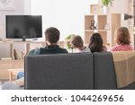 happy family watching tv at home | Shutterstock . vector #1044269656