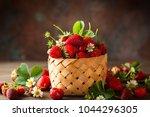 fresh strawberry in basket on... | Shutterstock . vector #1044296305