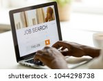 african man browsing work... | Shutterstock . vector #1044298738