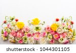 festive flower composition on... | Shutterstock . vector #1044301105