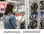 happy young woman customer... | Shutterstock . vector #1044334525