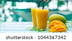 fresh tropical fruit smoothie... | Shutterstock . vector #1044367342