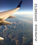 Small photo of Air travel over mountains