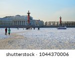 Small photo of ST.PETERSBURG, RUSSIA - MARCH 07, 2018: MOE boat warns of the danger of being on the ice of the Neva river against the backdrop of Rostral columns in winter on a Sunny day in Saint-Petersburg