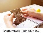 woman placing baby's sonogram... | Shutterstock . vector #1044374152
